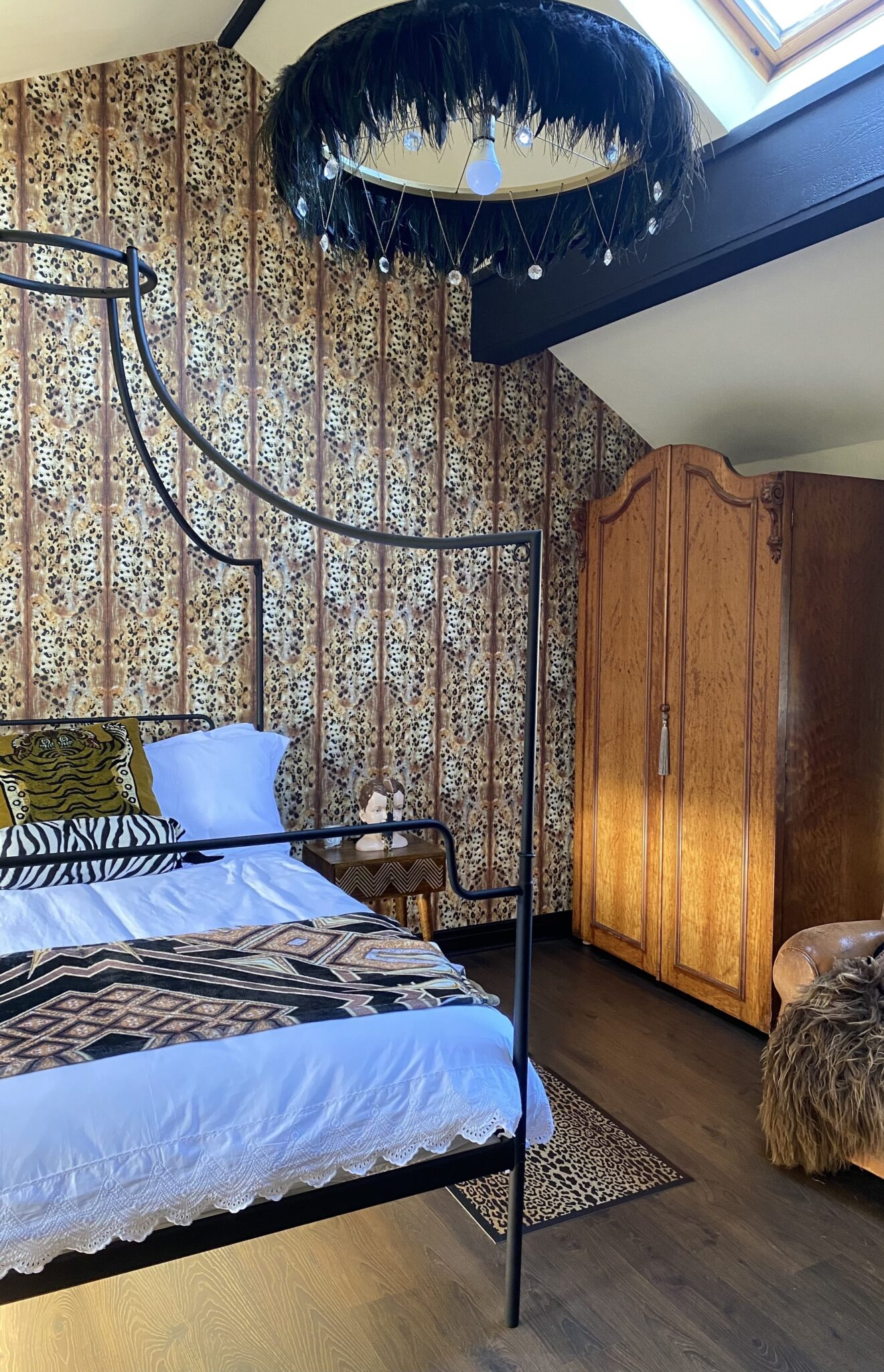 vintage-wardrobe-in-beroom-with-a-four-poster-bed